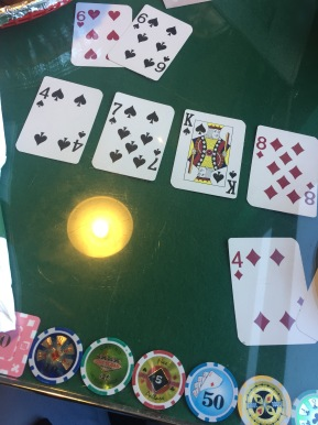 Cards and poker chips in the table